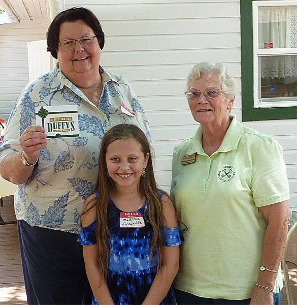 Winner Cindy Luettich with Madison and Marlene Fernandez,