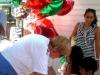 bev-macnellis-treasurer-gives-balloons-to-the-kids