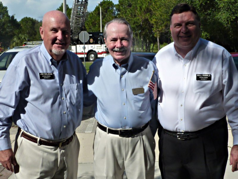 Charles Dauray, president of EHS flank by coucilmen Jim Wilson and Bill Ribble