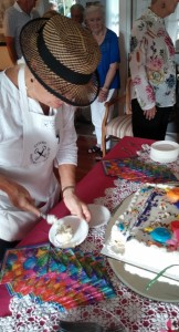 Carolyn Fischer cutting the cake