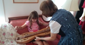 Docent - Joyce giving Madison a lesson in playing the docent